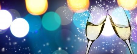 Foto de Two glasses of champagne with colorful lights in the background - Imagen libre de derechos