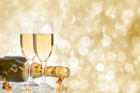 Photo pour Glasses with champagne and bottle over fireworks and sparkling holiday background - image libre de droit