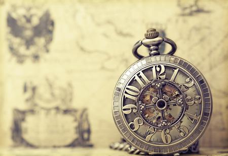 Foto de Vintage watch on antique map. Retro still life - Imagen libre de derechos
