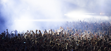 Photo for Cheering crowd at a concert - Royalty Free Image