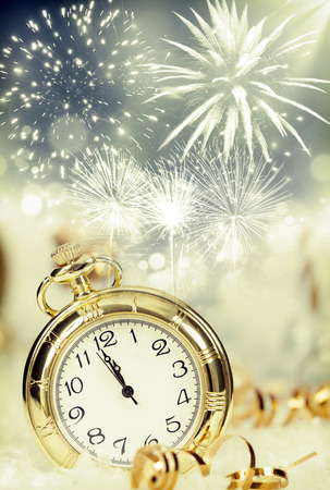 Photo pour New Year's at midnight - Old clock with fireworks and holiday lights - image libre de droit