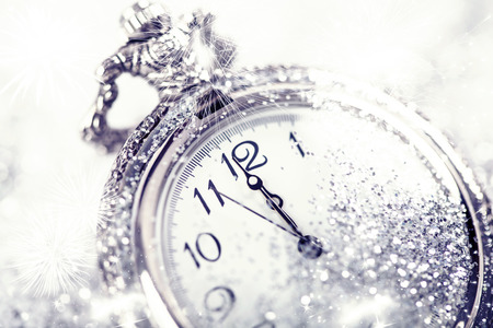 Photo pour New Year's at midnight - Old clock with stars snowflakes and holiday lights - image libre de droit
