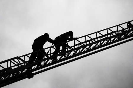 Photo pour Firefighter and child on ladder - image libre de droit