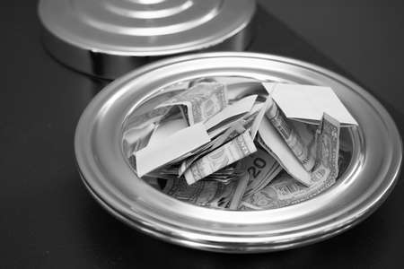 Foto de A tithe plate with money in it. Black and white. - Imagen libre de derechos