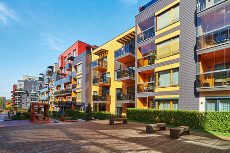 Photo pour Benches at Modern complex of apartment residential buildings. With other outdoor facilities. - image libre de droit