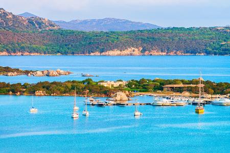 Foto de Harbor with boats at Porto Rotondo in Golfo Aranci in Costa Smeralda resort in Mediterranean sea, Sardinia, Italy - Imagen libre de derechos