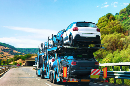 Photo for Car transporter on the road in Nuoro, Sardinia, Italy - Royalty Free Image