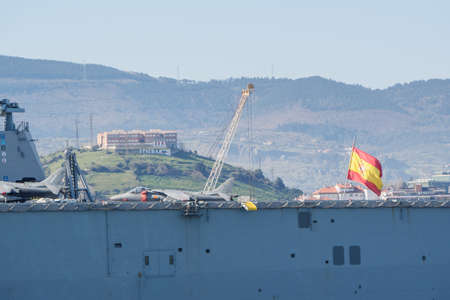 Foto de BILBAO, SPAIN - MARCH / 23/2019. The aircraft carrier of the Spanish Navy Juan Carlos I in the port of Bilbao, open day to visit the ship. Sunny day - Imagen libre de derechos