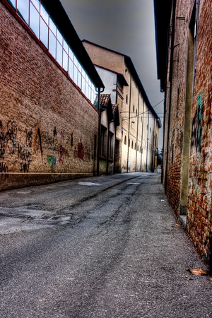 street in the twilight, night is falling in the decadent old town, grunge dark alley at dusk, evening in slums of the city, urban decay