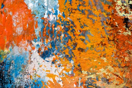 brush strokes of oil painting on canvas - detail of impressionist art work - orange, red, blue, white abstract texture