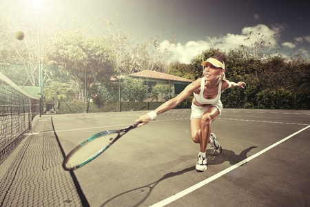 Foto de portrait of young beautiful woman playing tennis in summer environment - Imagen libre de derechos