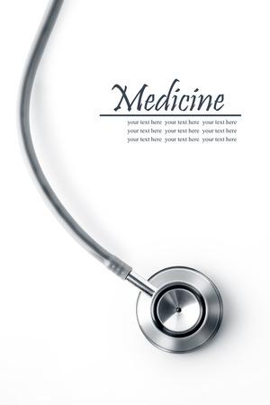 Foto de Close up view of grey stethoscope on white back - Imagen libre de derechos