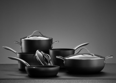 Photo for close up view of nice cookware set on grey color back - Royalty Free Image