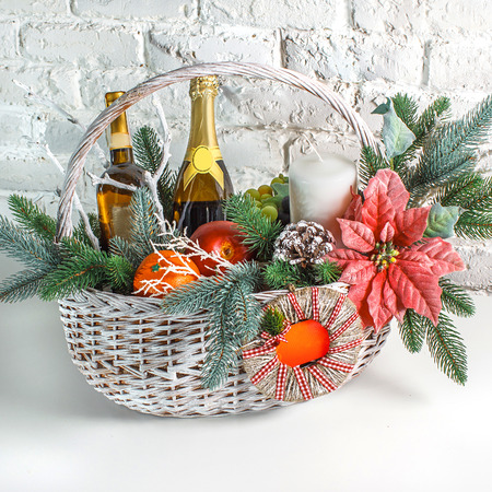 Photo for Christmas gift basket on the white background - Royalty Free Image