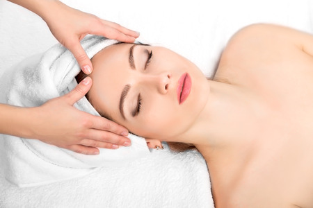 Photo pour Young beautiful  attractive woman receiving facial massage and spa treatment. Perfect Skin. Skincare. Young Skin - image libre de droit