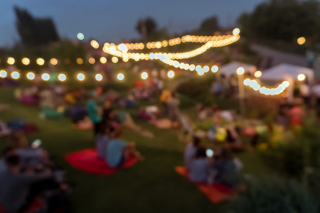 Photo pour blur people picnic in a public Park with family or friends. the food festival at night - image libre de droit