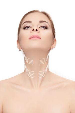Photo pour woman with arrows on face over white background. neck lifting co - image libre de droit