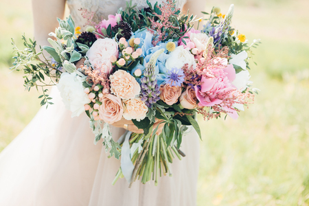 Foto de brides hands hold beautiful bridal bouquet of peony. fine art photography. - Imagen libre de derechos