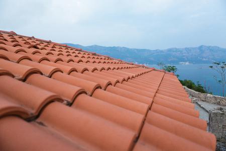Photo pour background of red brick roofs, Montenegro - image libre de droit