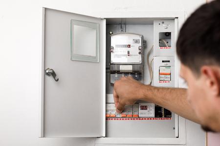 Foto de Electrical terminal box. man turn on or off - Imagen libre de derechos