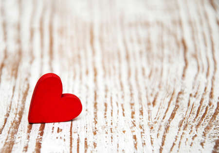 Photo for Red heart on a old wooden  background - Royalty Free Image