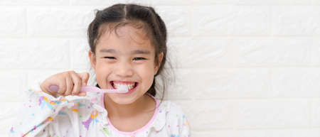 Photo for Little asian cute girl brush teeth - Royalty Free Image
