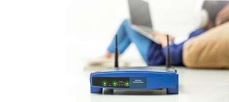 Foto für Wireless router and kids using a laptop in home. router wireless broadband home laptop computer phone wifi concept - Lizenzfreies Bild