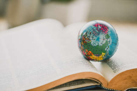 Foto de World globe on  book. education school Concept - Imagen libre de derechos