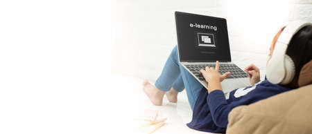 Photo for asian child asian child using laptop with inscription on screen e-learning . Online education,e-learning. - Royalty Free Image