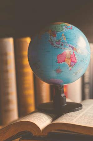 Foto de World globe on  book. education school Concept - Imagen libre de derechos