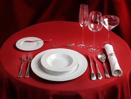 Photo for Red table with dinner set. Professional banquet table setting - Royalty Free Image