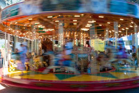 Photo pour Sydney, Australia - November 30, 2008: Moving Marry go round carousel in motion blur - image libre de droit