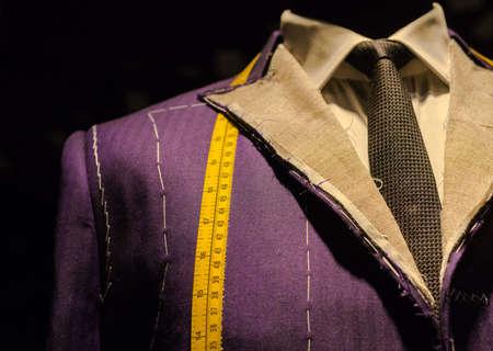 Photo pour Work in Progress Suit on Mannequin with Yellow Tape Measure - image libre de droit
