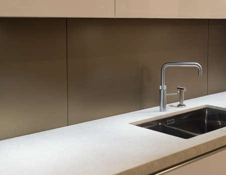Foto de Clean and Contemporary Kitchen Worktop with Steel Faucet and Sink - Imagen libre de derechos