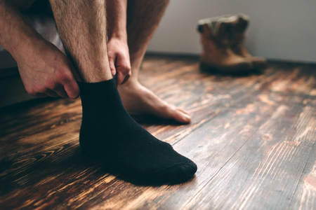 Photo pour The man wears black socks. Mens style. - image libre de droit