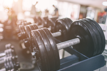 Photo for Black dumbbell set. Close up many dumbbells in sport fitness center. Rows in the gym with hign contrast and color tone sport and health concept. - Royalty Free Image