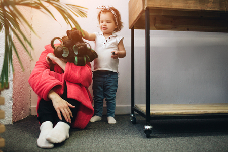 Photo for Young mother old is experiencing postnatal depression. Sad and tired woman with PPD. She does not want to play with her daughter - Royalty Free Image