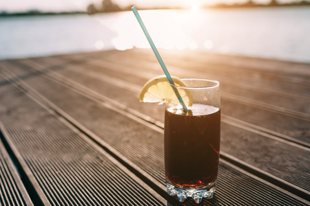 Photo for Concept of luxury vacation. Cola on wooden pier. Clear blue sky. Horizontal, wide screen format. - Royalty Free Image