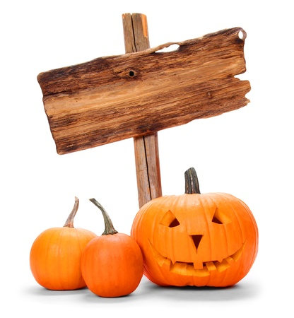 Halloween pumpkins with wooden sign isolated on white