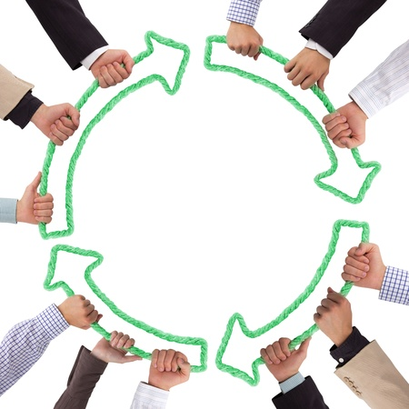 Hands holding green arrows