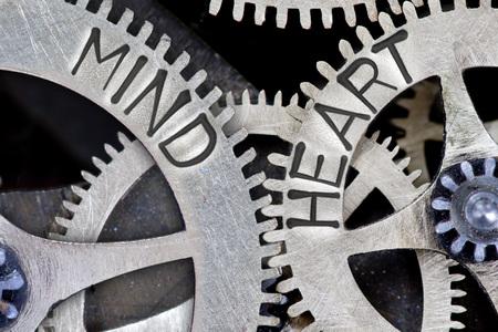 Foto de Macro photo of tooth wheel mechanism with imprinted MIND, HEART concept words - Imagen libre de derechos