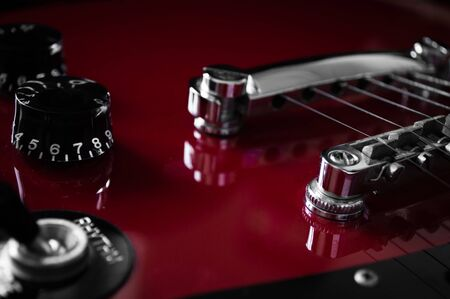 Photo for Red electric guitar with neck strings, fingerboards closeup isolated on black background - Royalty Free Image