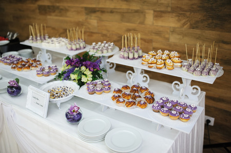 Photo for wedding dessert with delicious cakes and macaroons - Royalty Free Image