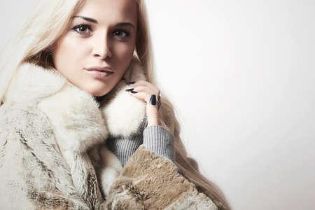 Photo for Beauty Fashion blond Model Girl in Mink Fur Coat. Beautiful Woman in Luxury Fur Jacket - Royalty Free Image