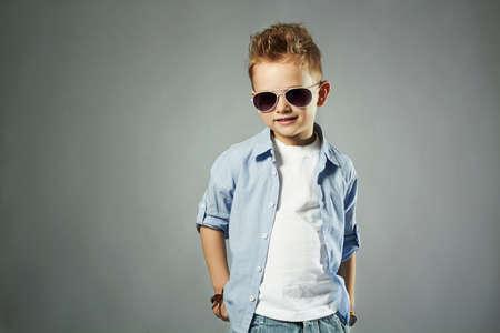 Photo pour fashionable little boy in sunglasses. fashion children - image libre de droit