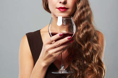 Photo pour beautiful woman with glass red wine. curly hairstyle - image libre de droit