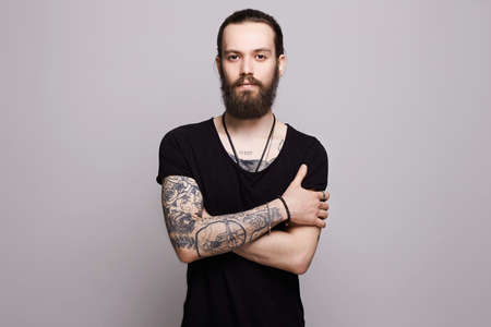 Foto de handsome bearded man.Brutal hipster boy with tattoo - Imagen libre de derechos