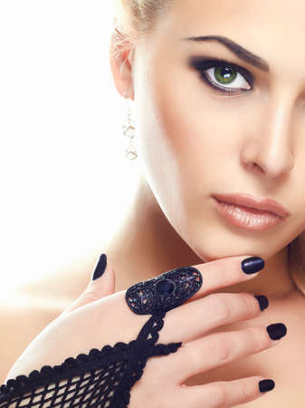 Photo for beaufiful young woman face.Sexy young Woman in Gloves.beauty model girl with make-up - Royalty Free Image