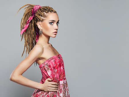 Photo for beautiful girl with dreadlocks hairstyle.trendy modern young woman with braids hairdo and make up - Royalty Free Image