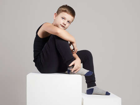 Photo pour Fashionable child in studio. little model boy - image libre de droit
